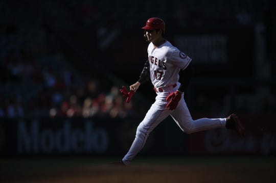 Jun 26, 2019; Anaheim, CA, USA; Los Angeles Angels designated hitter Shohei Ohtani (17) round second off a single by left fielder Justin Upton (8) during the first inning against the Cincinnati Reds at Angel Stadium of Anaheim. Mandatory Credit: Kelvin Kuo-USA TODAY Sports