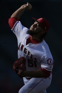 Jun 26, 2019; Anaheim, CA, USA; Los Angeles Angels starting pitcher Jaime Barria (51) pitches during the first inning against the Cincinnati Reds at Angel Stadium of Anaheim. Mandatory Credit: Kelvin Kuo-USA TODAY Sports
