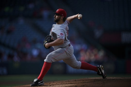 Jun 26, 2019; Anaheim, CA, USA; Cincinnati Reds starting pitcher Tanner Roark (35) pitches during the first inning against the Los Angeles Angels at Angel Stadium of Anaheim. Mandatory Credit: Kelvin Kuo-USA TODAY Sports