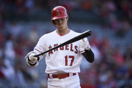 Jun 26, 2019; Anaheim, CA, USA; Los Angeles Angels designated hitter Shohei Ohtani (17) reacts after a strike during the first inning against the Cincinnati Reds at Angel Stadium of Anaheim. Mandatory Credit: Kelvin Kuo-USA TODAY Sports