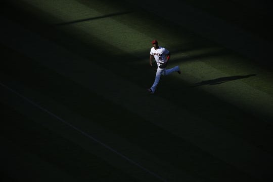 Jun 26, 2019; Anaheim, CA, USA; Los Angeles Angels left fielder Justin Upton (8) fields a ball during the third inning against the Cincinnati Reds at Angel Stadium of Anaheim. Mandatory Credit: Kelvin Kuo-USA TODAY Sports