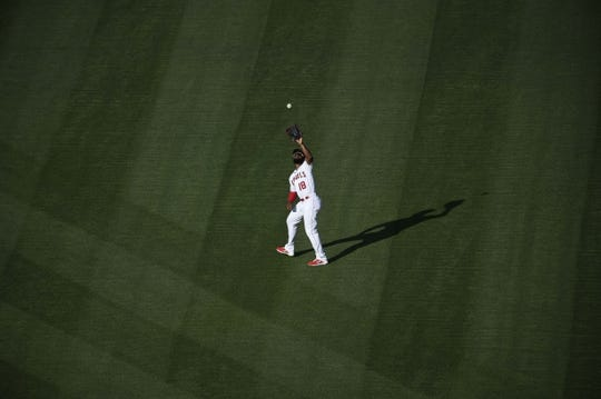 Jun 26, 2019; Anaheim, CA, USA; Los Angeles Angels right fielder Brian Goodwin (18) fields a ball during the fourth inning against the Cincinnati Reds at Angel Stadium of Anaheim. Mandatory Credit: Kelvin Kuo-USA TODAY Sports