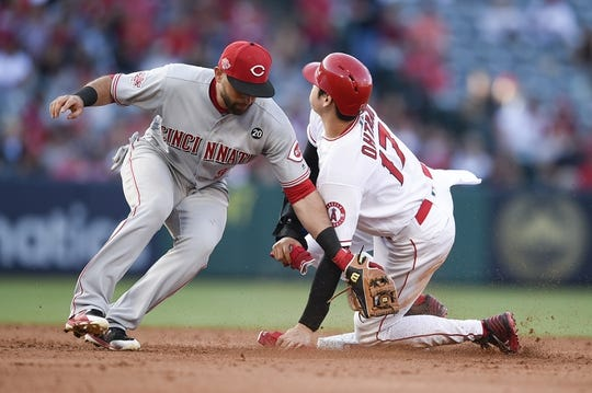 Jun 26, 2019; Anaheim, CA, USA; Los Angeles Angels designated hitter Shohei Ohtani (17) steals second base ahead of the tag by Cincinnati Reds second baseman Jose Peraza (9) during the sixth inning at Angel Stadium of Anaheim. Mandatory Credit: Kelvin Kuo-USA TODAY Sports