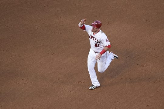 Jun 26, 2019; Anaheim, CA, USA; Los Angeles Angels first baseman Jusin Bour (41) reacts while rounding the bases after hitting a solo home run during the fifth inning against the Cincinnati Reds at Angel Stadium of Anaheim. Mandatory Credit: Kelvin Kuo-USA TODAY Sports
