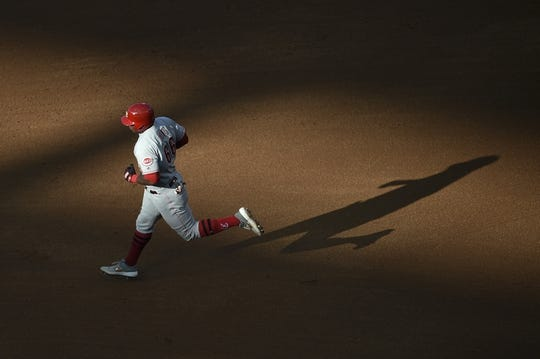 Jun 26, 2019; Anaheim, CA, USA; Cincinnati Reds right fielder Yasiel Puig (66) rounds the bases after hitting a solo home run during the fifth inning against the Los Angeles Angels at Angel Stadium of Anaheim. Mandatory Credit: Kelvin Kuo-USA TODAY Sports