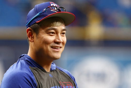Jun 28, 2019; St. Petersburg, FL, USA; Texas Rangers designated hitter Shin-Soo Choo (17) works out prior to a game against the Tampa Bay Rays at Tropicana Field. Mandatory Credit: Kim Klement-USA TODAY Sports