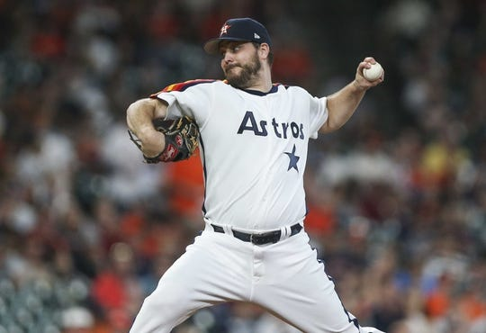 Jun 28, 2019; Houston, TX, USA; Houston Astros starting pitcher Wade Miley (20) delivers a pitch during the first inning against the Seattle Mariners at Minute Maid Park. Mandatory Credit: Troy Taormina-USA TODAY Sports