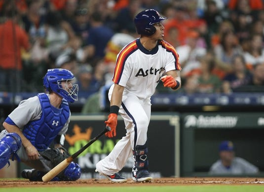 Jun 28, 2019; Houston, TX, USA; Houston Astros left fielder Michael Brantley (23) hits a single during the first inning against the Seattle Mariners at Minute Maid Park. Mandatory Credit: Troy Taormina-USA TODAY Sports