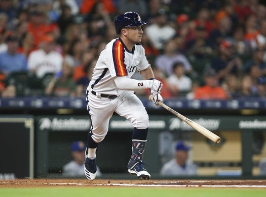 Jun 28, 2019; Houston, TX, USA; Houston Astros shortstop Alex Bregman (2) hits a single during the first inning against the Seattle Mariners at Minute Maid Park. Mandatory Credit: Troy Taormina-USA TODAY Sports