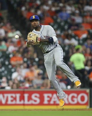 Jun 28, 2019; Houston, TX, USA; Seattle Mariners third baseman Tim Beckham (1) throws out a runner at first base during the first inning against the Houston Astros at Minute Maid Park. Mandatory Credit: Troy Taormina-USA TODAY Sports