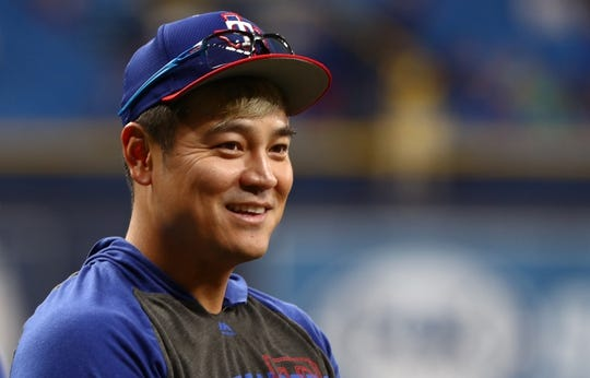 Jun 28, 2019; St. Petersburg, FL, USA; Texas Rangers designated hitter Shin-Soo Choo (17) works out prior to the game against the Tampa Bay Rays at Tropicana Field. Mandatory Credit: Kim Klement-USA TODAY Sports