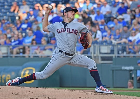 Jul 2, 2019; Kansas City, MO, USA; Cleveland Indians starting pitcher Trevor Bauer (47) delivers a pitch against the Kansas City Royals during the first inning at Kauffman Stadium. Mandatory Credit: Peter G. Aiken/USA TODAY Sports