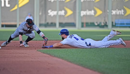 Jul 2, 2019; Kansas City, MO, USA; Kansas City Royals left fielder Alex Gordon (4) is tagged out by Cleveland Indians second baseman Jason Kipnis (22) at second base during the first inning at Kauffman Stadium. Mandatory Credit: Peter G. Aiken/USA TODAY Sports