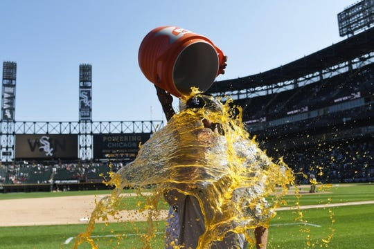 Jul 3, 2019; Chicago, IL, USA; Chicago White Sox starting pitcher Dylan Cease (84) is doused with liquid after recording his first MLB win against the Detroit Tigers in the first game of a baseball doubleheader at Guaranteed Rate Field. Mandatory Credit: David Banks-USA TODAY Sports