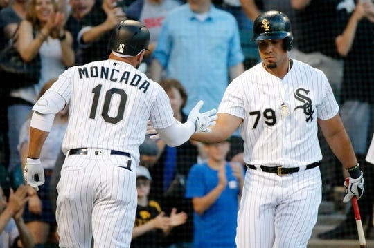 Jul 3, 2019; Chicago, IL, USA; Chicago White Sox third baseman Yoan Moncada (10) high fives first baseman Jose Abreu (79) after hitting a home run against the Detroit Tigers during the first inning in game two of a baseball doubleheader at Guaranteed Rate Field. Mandatory Credit: Jon Durr-USA TODAY Sports