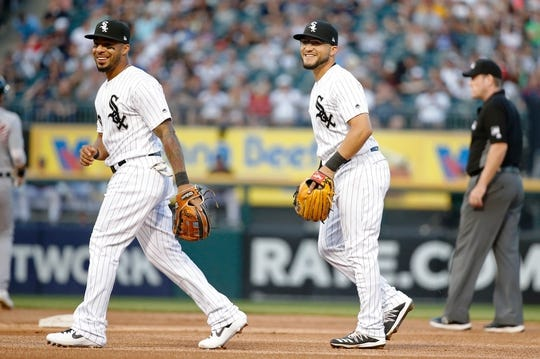 Jul 3, 2019; Chicago, IL, USA; Chicago White Sox shortstop Leury Garcia (left) and second baseman Yolmer Sanchez (right) smile after completing a double play against the Detroit Tigers to end the first inning in game two of a baseball doubleheader at Guaranteed Rate Field. Mandatory Credit: Jon Durr-USA TODAY Sports
