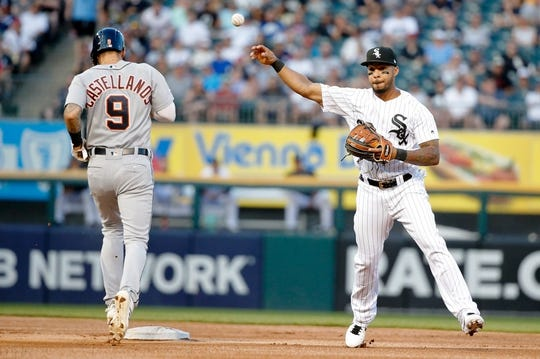 Jul 3, 2019; Chicago, IL, USA; Chicago White Sox shortstop Leury Garcia (28) throws to first base after forcing out Detroit Tigers right fielder Nicholas Castellanos (9) to complete a double play to end the first inning in game two of a baseball doubleheader at Guaranteed Rate Field. Mandatory Credit: Jon Durr-USA TODAY Sports