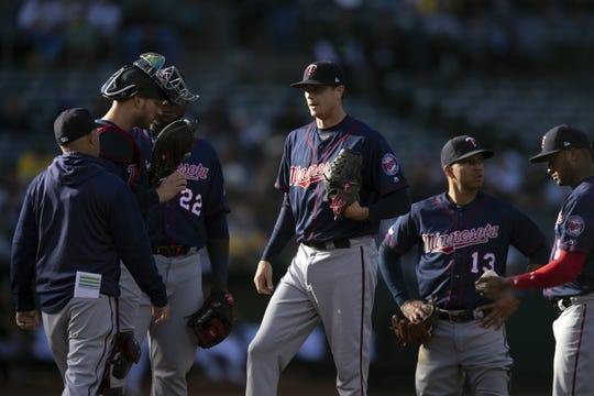 Jul 3, 2019; Oakland, CA, USA; Minnesota Twins pitching coach Wes Johnson (left) talks with starting pitcher Kyle Gibson (44) during the second inning at Oakland Coliseum. Mandatory Credit: D. Ross Cameron-USA TODAY Sports