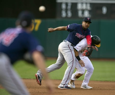 Jul 3, 2019; Oakland, CA, USA; Minnesota Twins second baseman Jonathan Schoop, left, throws over Oakland Athletics Robbie Grossman in a futile effort to double up Franklin Barreto during the fourth inning of a baseball game at Oakland Coliseum. Mandatory Credit: D. Ross Cameron-USA TODAY Sports