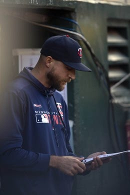 Jul 3, 2019; Oakland, CA, USA; Minnesota Twins manager Rocco Baldelli checks his lineup card during the fourth inning of a baseball game against the Oakland Athletics at Oakland Coliseum. Mandatory Credit: D. Ross Cameron-USA TODAY Sports
