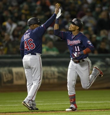 Jul 3, 2019; Oakland, CA, USA; Minnesota Twins designated hitter Jorge Polanco (11) gets a congratulatory high five from third base coach Tony Diaz (46) after hitting a solo home run during the eighth inning of a baseball game against the Oakland Athletics at Oakland Coliseum. Mandatory Credit: D. Ross Cameron-USA TODAY Sports