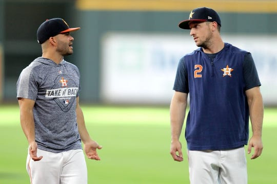 Jul 5, 2019; Houston, TX, USA; Houston Astros second baseman Jose Altuve (27, left) and Houston Astros third baseman Alex Bregman (2, right) talk during warmups prior to the game against the Los Angeles Angels at Minute Maid Park. Mandatory Credit: Erik Williams-USA TODAY Sports
