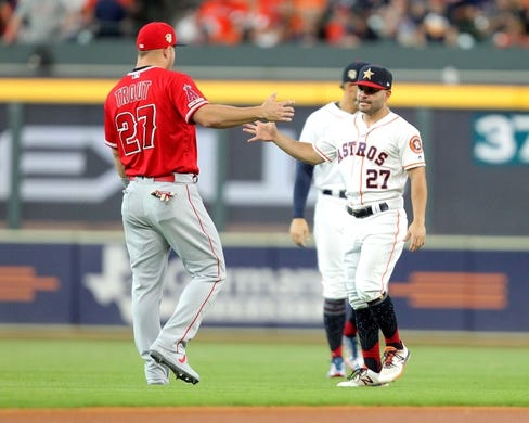 Jul 5, 2019; Houston, TX, USA; Los Angeles Angels center fielder Mike Trout (27) greets Houston Astros second baseman Jose Altuve (27) prior to the game at Minute Maid Park. Mandatory Credit: Erik Williams-USA TODAY Sports