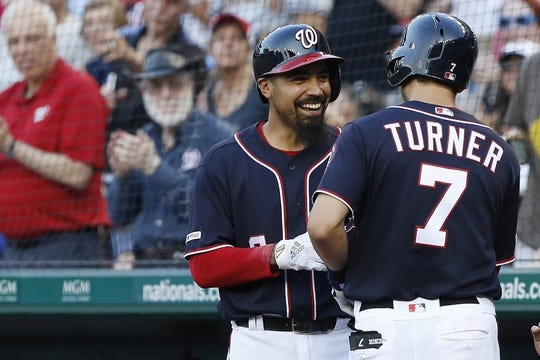 Jul 5, 2019; Washington, DC, USA; Washington Nationals shortstop Trea Turner (7) celebrates with Nationals third baseman Anthony Rendon (6) after hitting a home run against the Kansas City Royals in the first inning at Nationals Park. Mandatory Credit: Geoff Burke-USA TODAY Sports