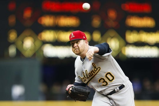 Jul 5, 2019; Seattle, WA, USA; Oakland Athletics starting pitcher Brett Anderson (30) throws against the Seattle Mariners during the first inning at T-Mobile Park. Mandatory Credit: Joe Nicholson-USA TODAY Sports
