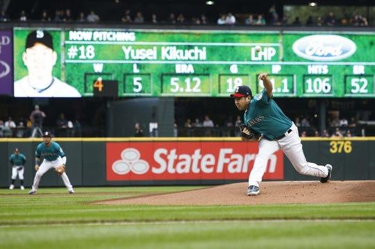 Jul 5, 2019; Seattle, WA, USA; Seattle Mariners starting pitcher Yusei Kikuchi (18) throws against the Oakland Athletics during the first inning at T-Mobile Park. Mandatory Credit: Joe Nicholson-USA TODAY Sports