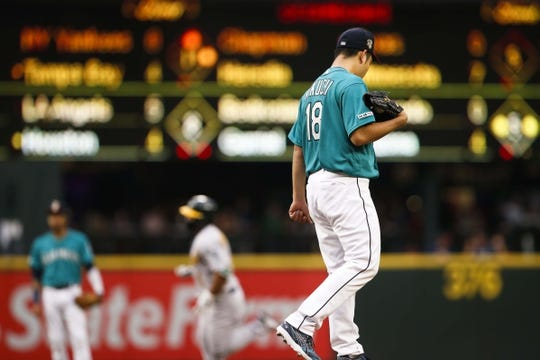 Jul 5, 2019; Seattle, WA, USA; Seattle Mariners starting pitcher Yusei Kikuchi (18) stands on the mound after surrendering a solo-home run to Oakland Athletics second baseman Franklin Barreto (1, background) during the third inning at T-Mobile Park. Mandatory Credit: Joe Nicholson-USA TODAY Sports