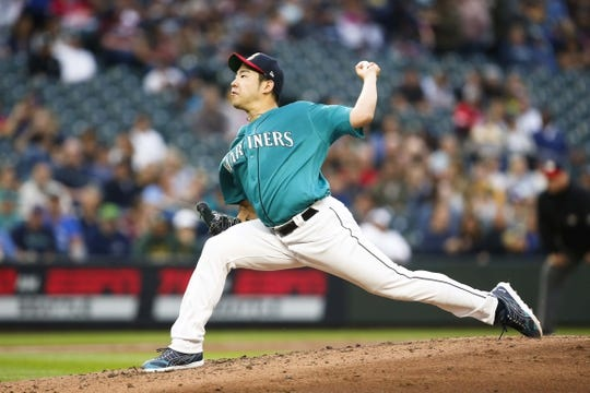 Jul 5, 2019; Seattle, WA, USA; Seattle Mariners starting pitcher Yusei Kikuchi (18) throws against the Oakland Athletics during the third inning at T-Mobile Park. Mandatory Credit: Joe Nicholson-USA TODAY Sports