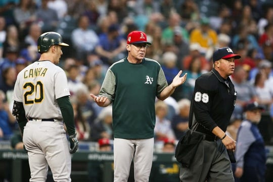Jul 5, 2019; Seattle, WA, USA; Oakland Athletics manager Bob Melvin (6) reacts after right fielder Mark Canha (20) grounded out against the Seattle Mariners during the fourth inning at T-Mobile Park. Mandatory Credit: Joe Nicholson-USA TODAY Sports