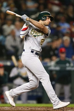 Jul 5, 2019; Seattle, WA, USA; Oakland Athletics first baseman Matt Olson (28) hits a ground rule double against the Seattle Mariners during the seventh inning at T-Mobile Park. Mandatory Credit: Joe Nicholson-USA TODAY Sports