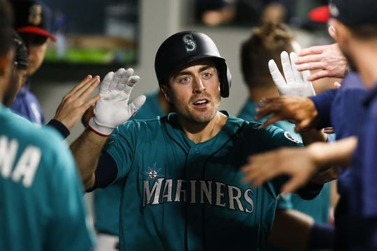 Jul 5, 2019; Seattle, WA, USA; Seattle Mariners catcher Tom Murphy (2) celebrates in the dugout after hitting a solo-home run against the Oakland Athletics during the fifth inning at T-Mobile Park. Mandatory Credit: Joe Nicholson-USA TODAY Sports