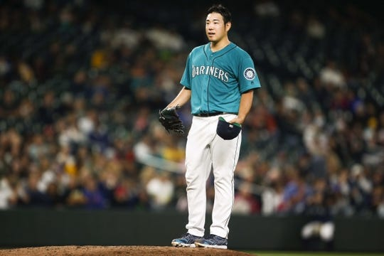 Jul 5, 2019; Seattle, WA, USA; Seattle Mariners starting pitcher Yusei Kikuchi (18) reacts to a warning from an umpire during the seventh inning against the Oakland Athletics at T-Mobile Park. Mandatory Credit: Joe Nicholson-USA TODAY Sports