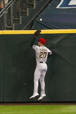Jul 5, 2019; Seattle, WA, USA; Oakland Athletics right fielder Mark Canha (20) fails to catch a home run against the Seattle Mariners during the fifth inning at T-Mobile Park. Mandatory Credit: Joe Nicholson-USA TODAY Sports