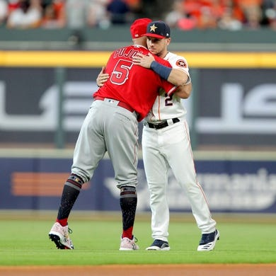 Jul 5, 2019; Houston, TX, USA; Los Angeles Angels first baseman Albert Pujols (5) greets Houston Astros third baseman Alex Bregman (2) prior to the game at Minute Maid Park. Mandatory Credit: Erik Williams-USA TODAY Sports