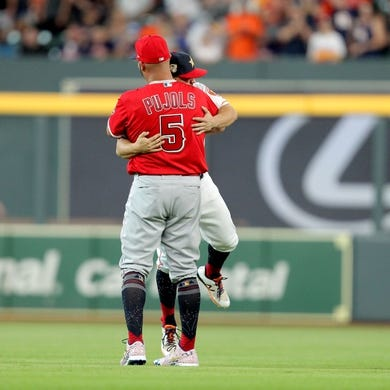 Jul 5, 2019; Houston, TX, USA; Los Angeles Angels first baseman Albert Pujols (5) greets Houston Astros second baseman Jose Altuve (27) prior to the game at Minute Maid Park. Mandatory Credit: Erik Williams-USA TODAY Sports