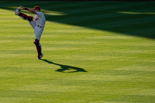 Jul 13, 2019; Philadelphia, PA, USA; Philadelphia Phillies catcher J.T. Realmuto (10) warms up before action against the Washington Nationals at Citizens Bank Park. Mandatory Credit: Bill Streicher-USA TODAY Sports