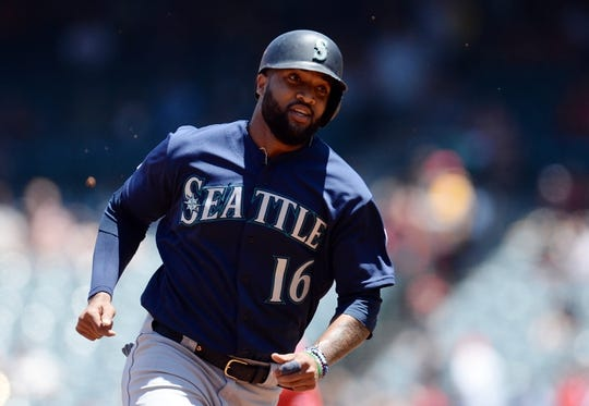 July 14, 2019; Anaheim, CA, USA; Seattle Mariners right fielder Domingo Santana (16) runs to third against the Los Angeles Angels during the first inning at Angel Stadium of Anaheim. Mandatory Credit: Gary A. Vasquez-USA TODAY Sports