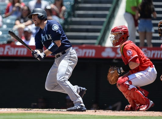 July 14, 2019; Anaheim, CA, USA; Seattle Mariners catcher Tom Murphy (2) hits an RBI single against the Los Angeles Angels during the first inning at Angel Stadium of Anaheim. Mandatory Credit: Gary A. Vasquez-USA TODAY Sports