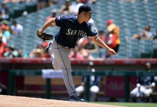 July 14, 2019; Anaheim, CA, USA; Seattle Mariners starting pitcher Yusei Kikuchi (18) throws against the Los Angeles Angels during the first inning at Angel Stadium of Anaheim. Mandatory Credit: Gary A. Vasquez-USA TODAY Sports