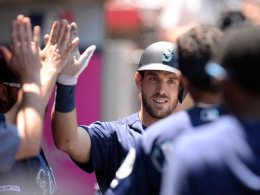 July 14, 2019; Anaheim, CA, USA; Seattle Mariners first baseman Austin Nola (23) is greeted after hitting a solo home run against the Los Angeles Angels during the second inning at Angel Stadium of Anaheim. Mandatory Credit: Gary A. Vasquez-USA TODAY Sports