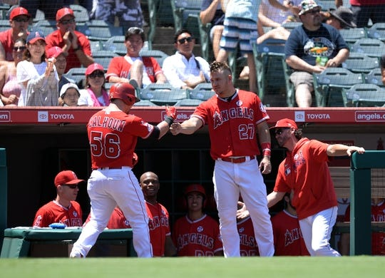 July 14, 2019; Anaheim, CA, USA; Los Angeles Angels center fielder Kole Calhoun (56) is greeted by center fielder Mike Trout (27) after hitting a solo home run against the Seattle Mariners during the second inning at Angel Stadium of Anaheim. Mandatory Credit: Gary A. Vasquez-USA TODAY Sports