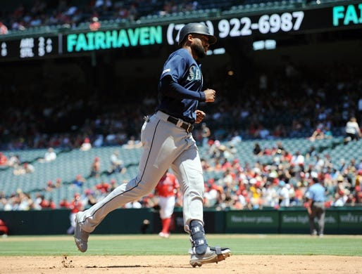 July 14, 2019; Anaheim, CA, USA; Seattle Mariners right fielder Domingo Santana (16) rounds the bases after hitting a solo home run against the Los Angeles Angels during the third inning at Angel Stadium of Anaheim. Mandatory Credit: Gary A. Vasquez-USA TODAY Sports