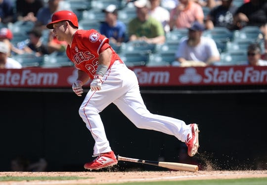 July 14, 2019; Anaheim, CA, USA; Los Angeles Angels third baseman Matt Thaiss (23) hits a single against the Seattle Mariners during the fifth inning  at Angel Stadium of Anaheim. Mandatory Credit: Gary A. Vasquez-USA TODAY Sports