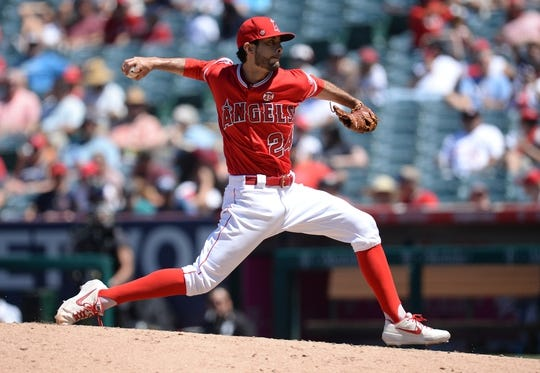 July 14, 2019; Anaheim, CA, USA; Los Angeles Angels relief pitcher Noe Ramirez (24) throws against the Seattle Mariners during the fifth inning at Angel Stadium of Anaheim. Mandatory Credit: Gary A. Vasquez-USA TODAY Sports