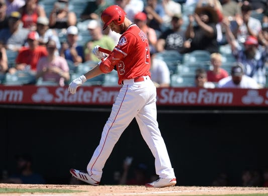July 14, 2019; Anaheim, CA, USA; Los Angeles Angels shortstop Andrelton Simmons (2) draws a bases loaded walk which allows catcher Dustin Garneau (13) to score a run against the Seattle Mariners during the fifth inning  at Angel Stadium of Anaheim. Mandatory Credit: Gary A. Vasquez-USA TODAY Sports