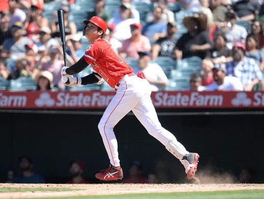 July 14, 2019; Anaheim, CA, USA; Los Angeles Angels designated hitter Shohei Ohtani (17) hits a sacrifice RBI against the Seattle Mariners during the fifth inning at Angel Stadium of Anaheim. Mandatory Credit: Gary A. Vasquez-USA TODAY Sports